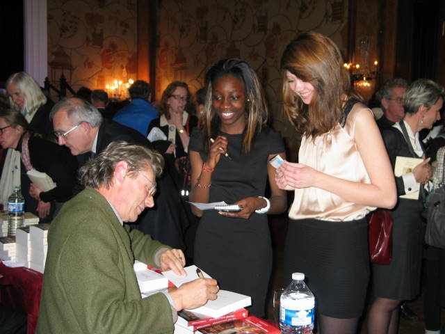 An author signing his book